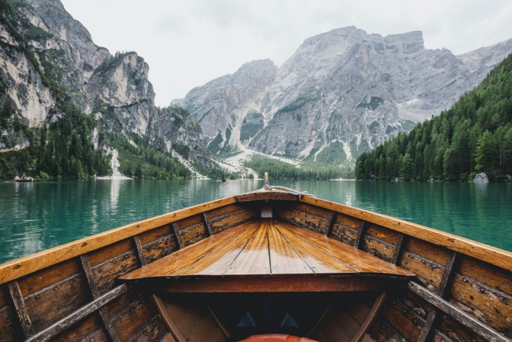 canoe on water with mountains