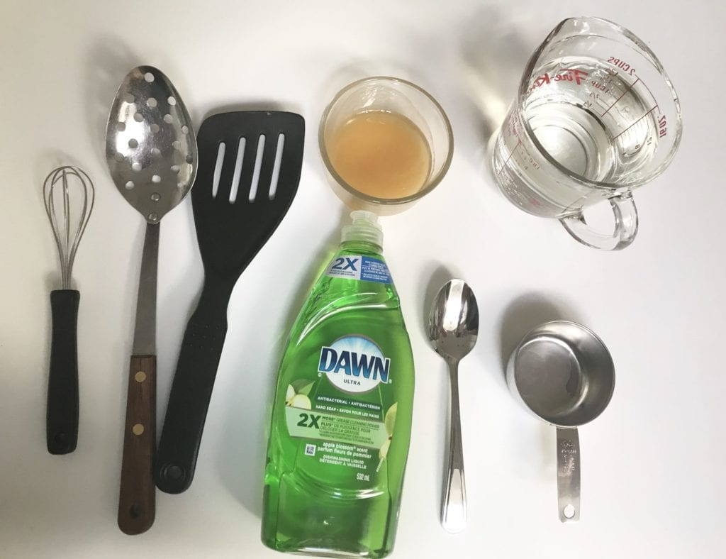 materials: dish soap, water in measuring cup, measuring spoons, honey, spoon and spatula with holes in them