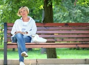 Woman in a park bench